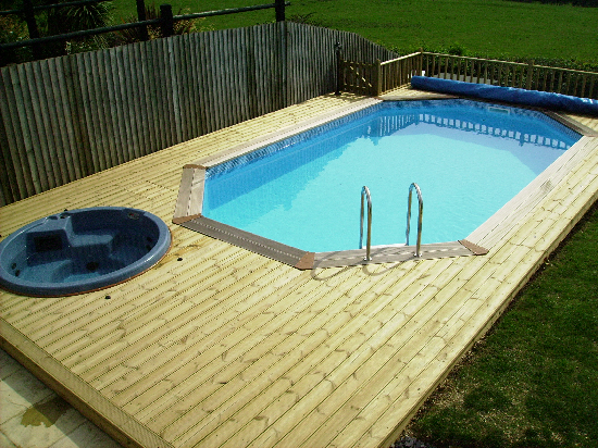Wooden decking swimming pools wooden decking for Above ground swimming pools uk